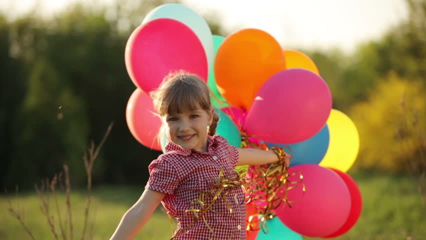 Child spinning with balloons in the park girl looking at camera child with balloons in the park hd stock footage clip altavistaventures Image collections