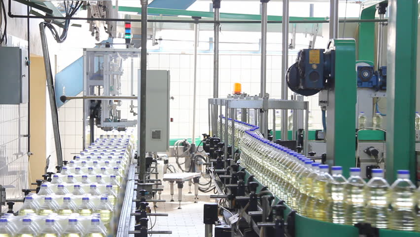 Sunflower oil in the bottle moving on production line in a factory