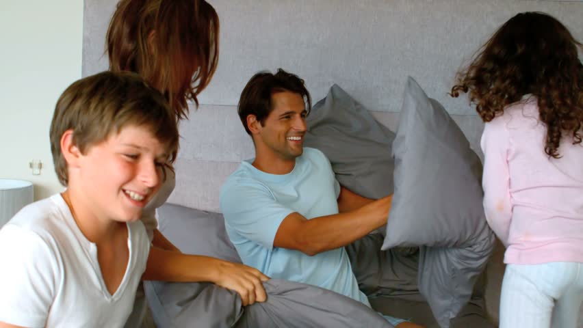 Smiling family having a pillow fight in slow motion at 250 frames per second | Shutterstock HD Video #3871160