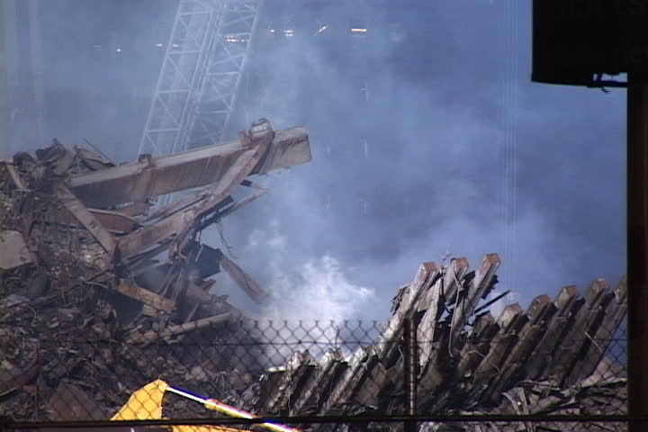 NEW YORK CITY - CIRCA SEPTEMBER 2001: Thick smoke rising from rubble at World Trade Center site.