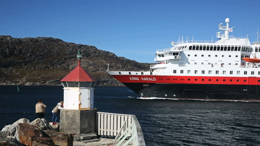 BODOE, NORWAY - MAY 2013: Along the coast of Norway the Hurtigruten ship is