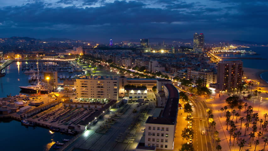 night timelapse of the beautiful barcelona skyline shot from a high vantage point