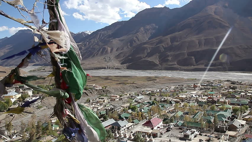 Tibetan flags above the village