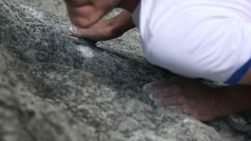 Details of a man rock climbing   Shutterstock HD Video #3888356