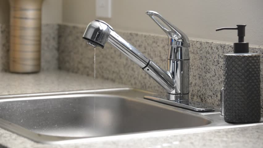 man turns off dripping kitchen sink faucet hd stock video clip