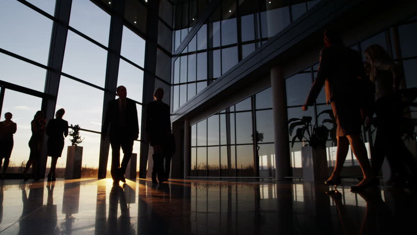 image business office. Silhouettes Of A Diverse Group Business People Walking Through Modern Glass Fronted Building At Image Office