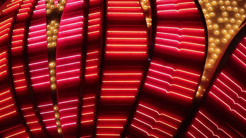 LAS VEGAS NEVADA APR 2013: Neon flashing lights of Las Vegas Casino. Flashing neon light on the famous Las Vegas Strip. Bright night entertainment and advertisement at resort hotel and casino.