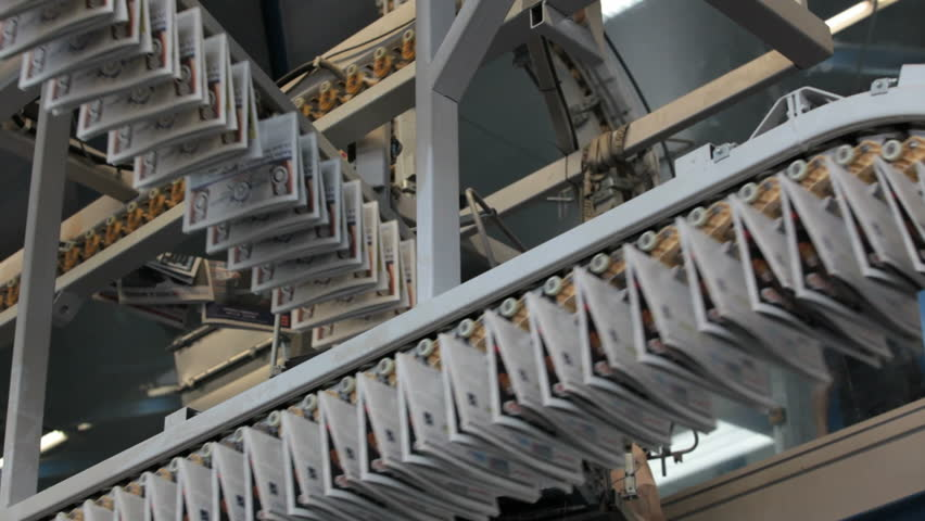 production lines crossing in newspaper printing press
