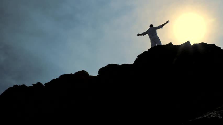 Christ Like Pose of a Man at the Top of a Hill Background HD | Shutterstock HD Video #3912086