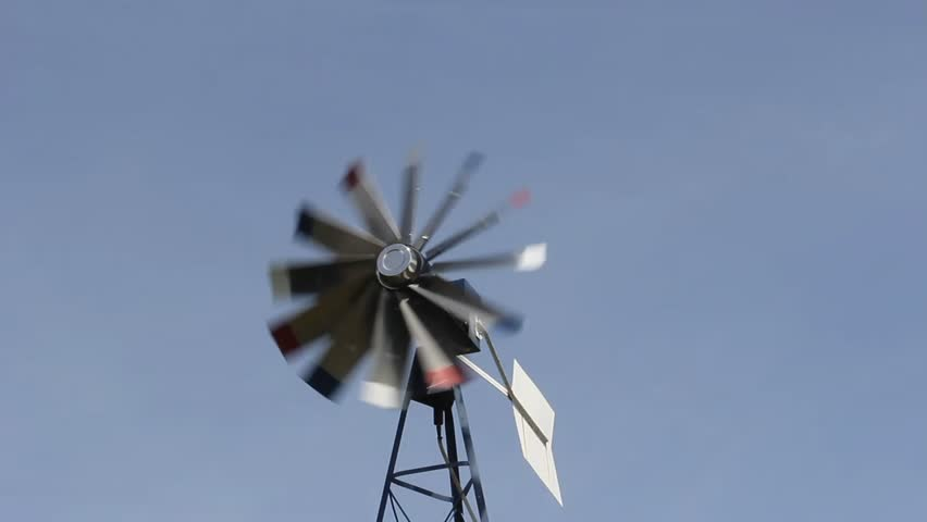 windmill aerator turning in the wind against a blue background