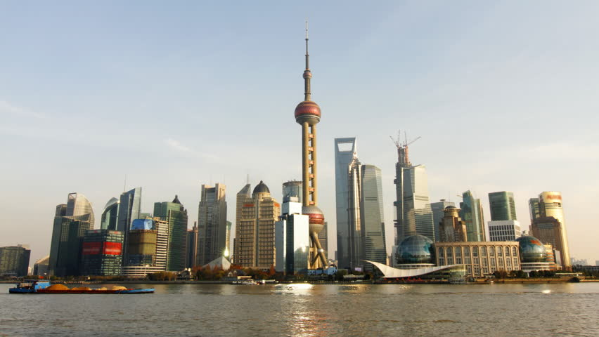 Time lapse of Shanghai skyline and busy Huangpu river - Shanghai, China.