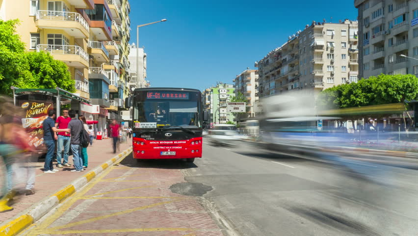 ANTALYA - APRIL 23 (TIMELAPSE): People waiting for city transport at bus stop on April 23, 2013 in Antalya, Turkey. Antalya is the biggest international sea resort, located on the Turkish Riviera.
