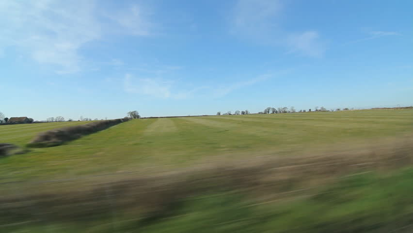 Drive in the country. Somerset fields. Driving past stone walls and fields in Somerset, UK.