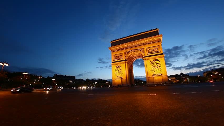 Arch of Triumph at dusk, Paris, France, Arc de Triumphe, Etoile, one of the monuments of Paris, including Eiffel tower, Louvre, Moulin Rouge, Versailles, Seine, Trocadero, Pompidou Center, Notre Dame,