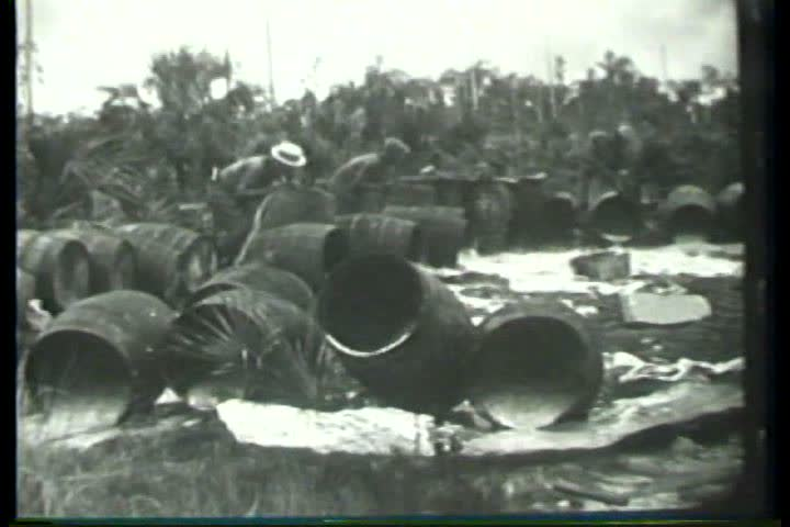 1920s - Federal officials pour out barrels of illegal moonshine during Prohibition in the 1920s.