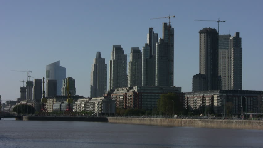 Office and residential towers of Puerto Madero harbor, Buenos Aires. Several construction cranes standing still (source HDV1080i, Can. HV30).