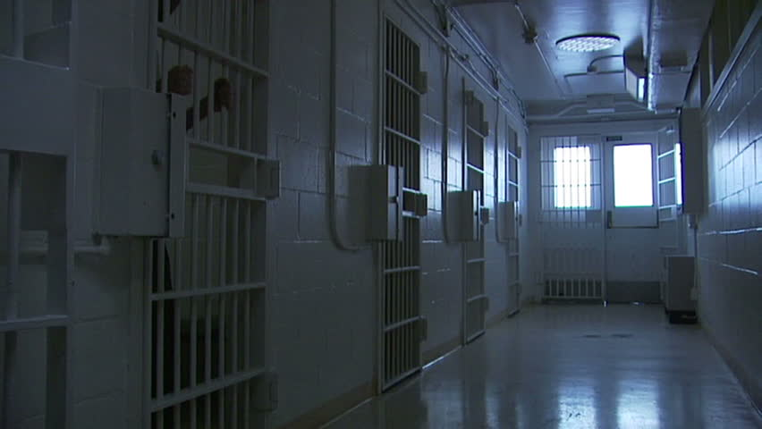 Perfect shot as B-roll for a piece of prison, violence, gangs. BONUS - an extra medium shot of an inmate holding the bars.