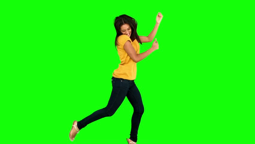 Woman jumping on green screen in slow motion #3997486