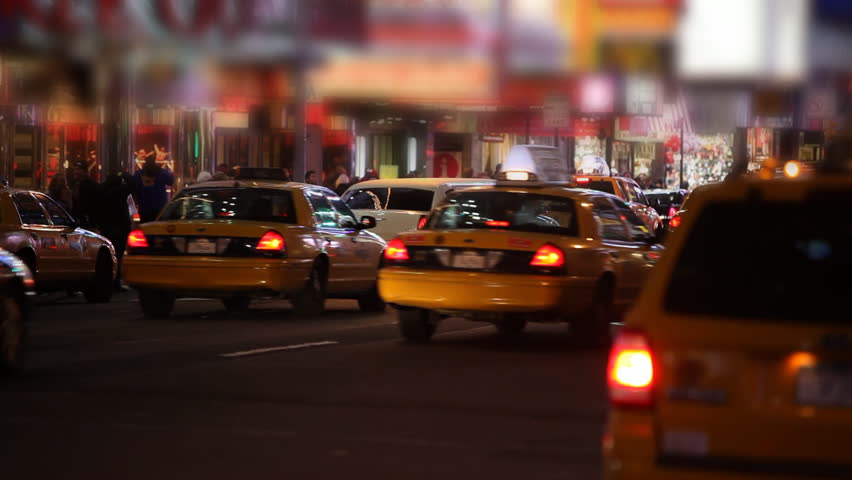 Taxis passing by on Times Square Manhattan, New York City / HD1080 / 29.97fps
