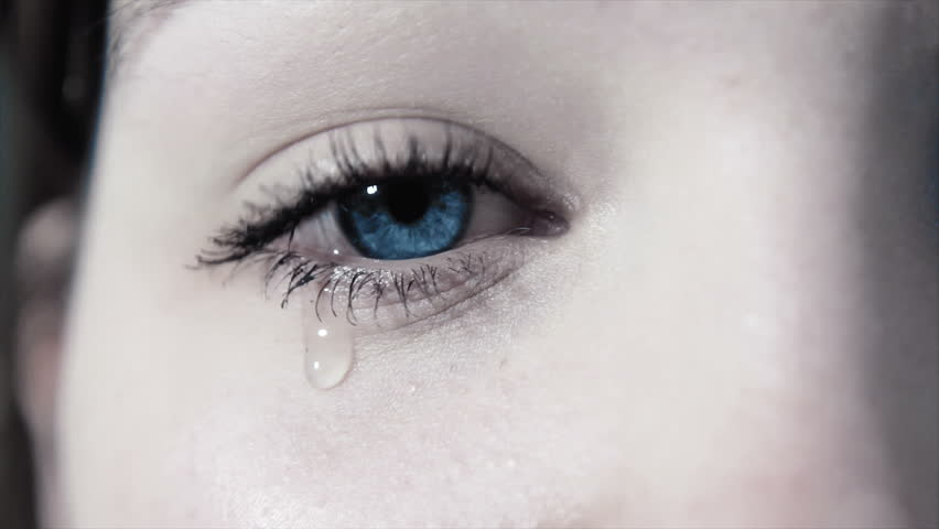 tears in a female sad eye in 1080p. a young girl weeping about sadness in 1080p