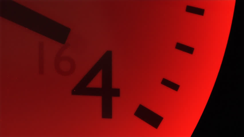 This high definition footage is of a red clock in the fourth hour with second hand ticks