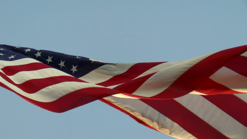 American flag, slow motion, waves, flutters, in wind, blue sky background, upward angle. 1080p
