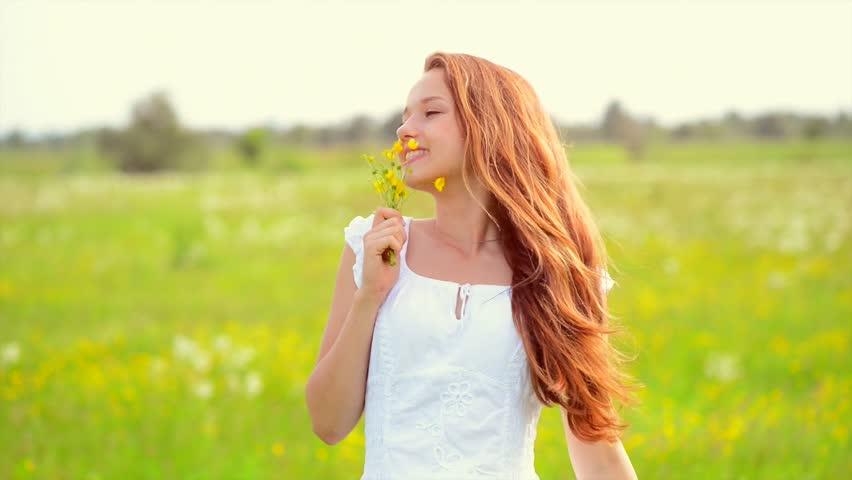Beauty Girl Enjoying Nature. Running And Jumping Outdoor. Beautiful Young Woman having Fun in the Meadow. Freedom concept. Crane Shot