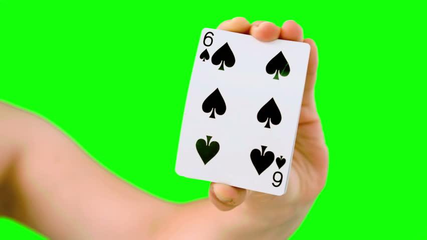 Hand shuffling and pushing cards towards camera on green screen