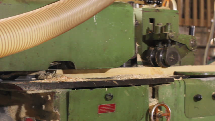 Wood grinding polishing old machine at sawmill factory