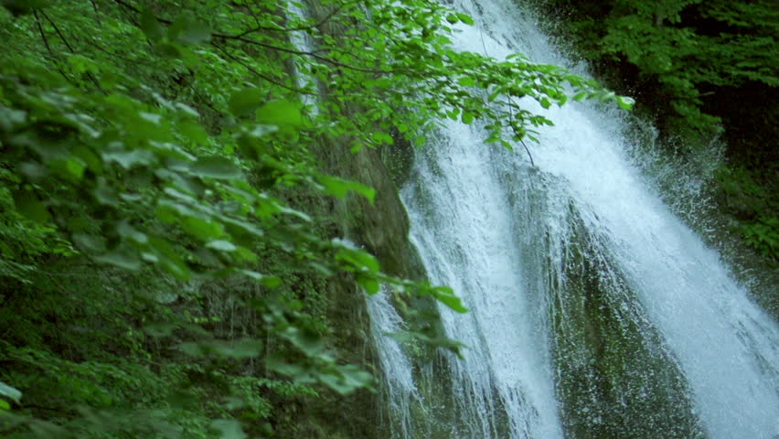 waterfall in mountains in slow motion, high speed reel. super slow motion dolly shot.