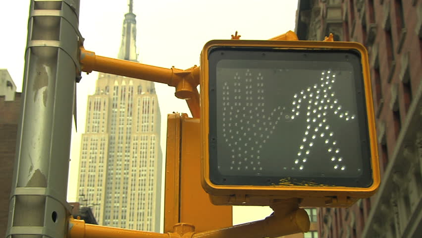 new york city pedestrain traffic signal, changing from green to red