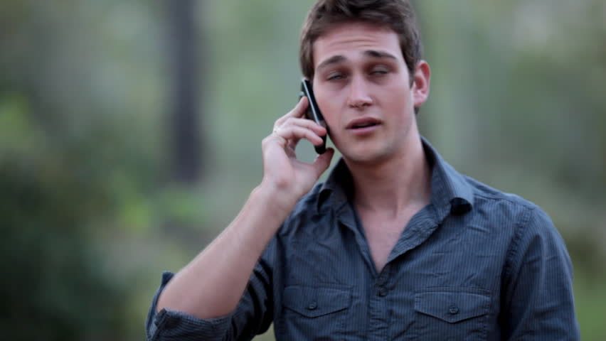 Casual young man receiving a phone call on his cell phone