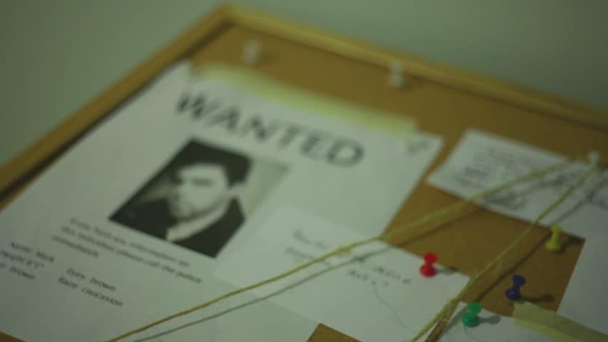 Information on a cork board. Police investigation concept.