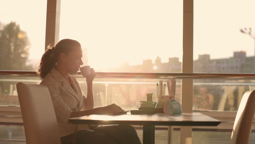 a young, beautiful woman drinking coffee #4087387