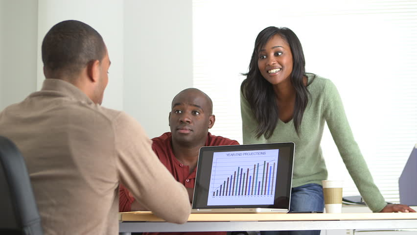 Two Black Business partners listening to their team leader