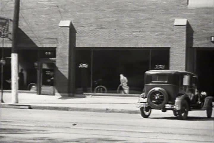 1920s - Car owners in the 1920s are encouraged to bring their cars in for regular service.