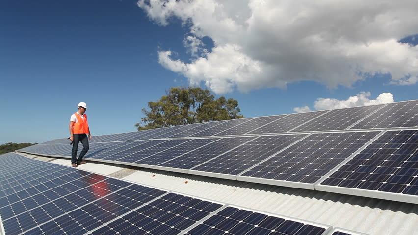 Technician inspecting solar panels on roof. HD | Shutterstock HD Video #4107436