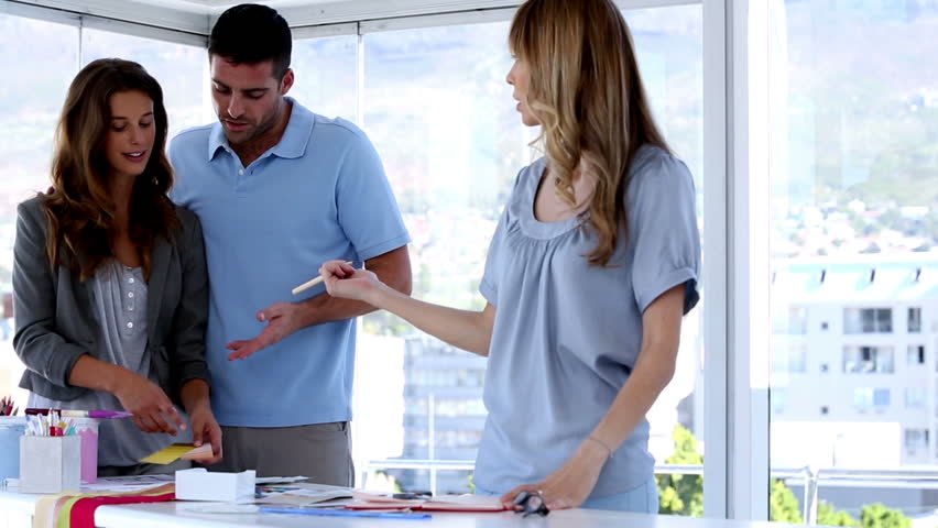 Interior Designers With Clients interior designer in meeting with clients in creative office stock