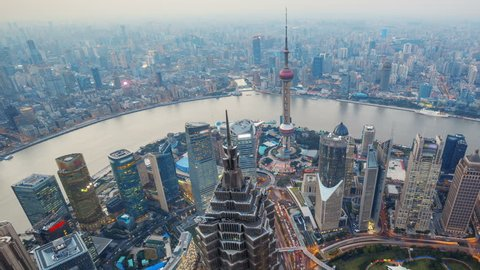 Shanghai From Day to Night, Time Lapse(Pan).  Aerial view of high-rise buildings with Huangpu River in Shanghai, China. - >>> Please Search Newest Featured Clip: 1020262945.