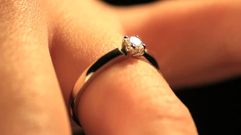 Engagement and wedding rings with diamonds on woman finger. Find similar clips in our portfolio.
