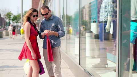 Young couple with smartphone in the city