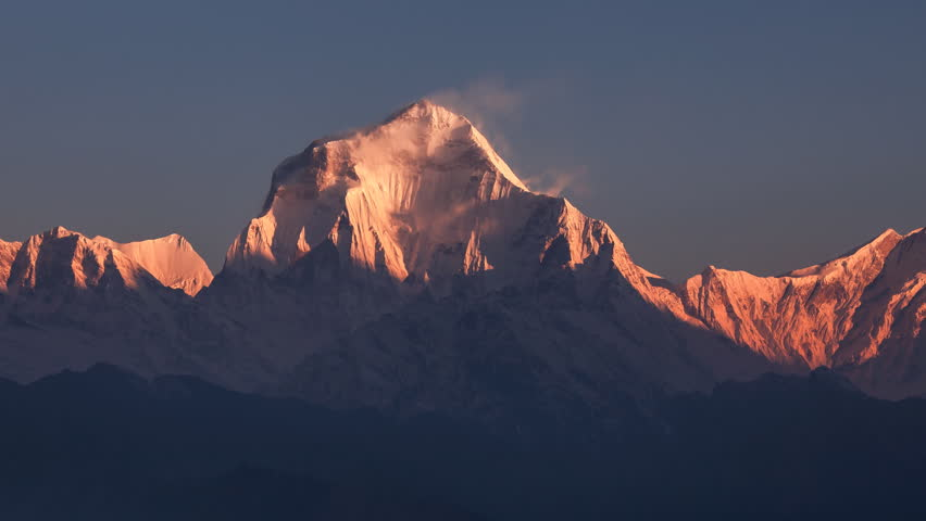 Snow avalanche falling from Dhaulagiri peak (8167 m) at sunrise. Time Lapse. Canon 5D Mk II.