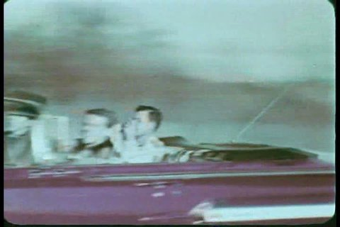 1960s - A couple of young men drive through a city an harass women with cat calls during the 1960s