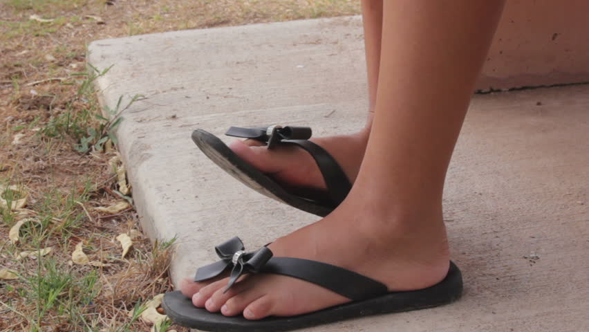 6b5f00a1e5b2cf hd00 15CU of Asian girl s feet in flip-flop-type sandals while sitting on