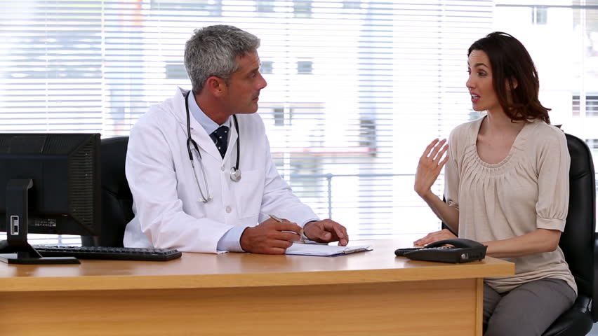 Patient explaining her pain to doctor