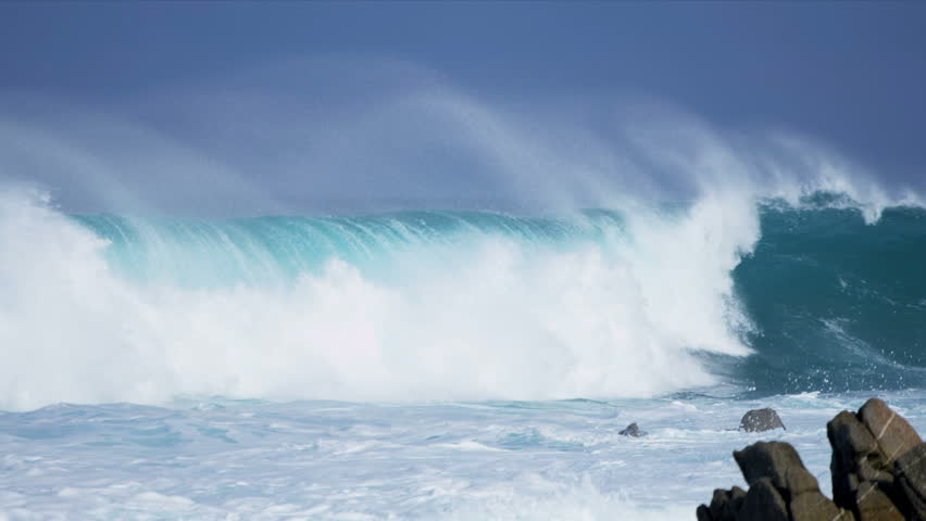 Pounding surf spray blue ocean waves washing over rocky coastline close up slow motion shot on RED EPIC | Shutterstock HD Video #4237496