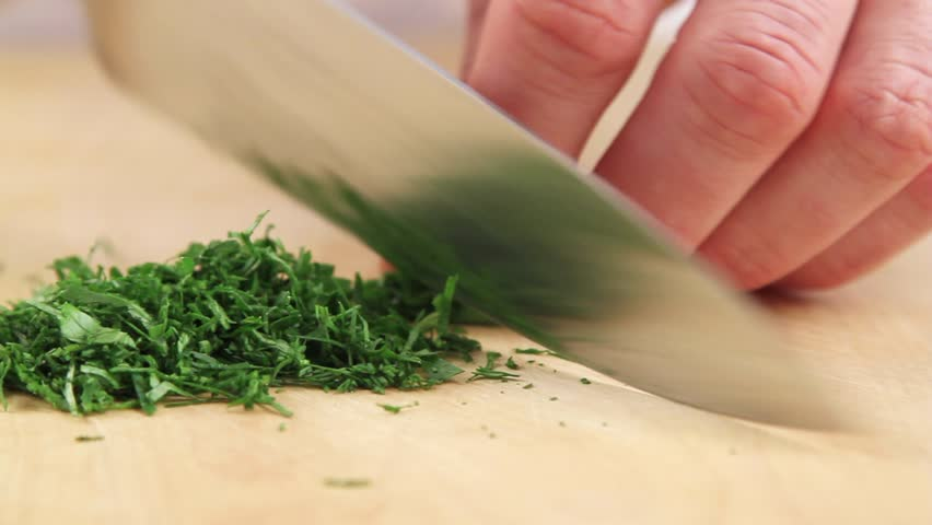 Dill and parsley being chopped #4238186