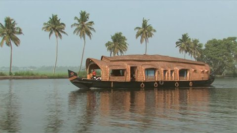 Alleppey India- 01/27/09- While on the traditional houseboat (Kettu Valam) observe daily activities of the village people. There are 900 km of labyrinth water world.