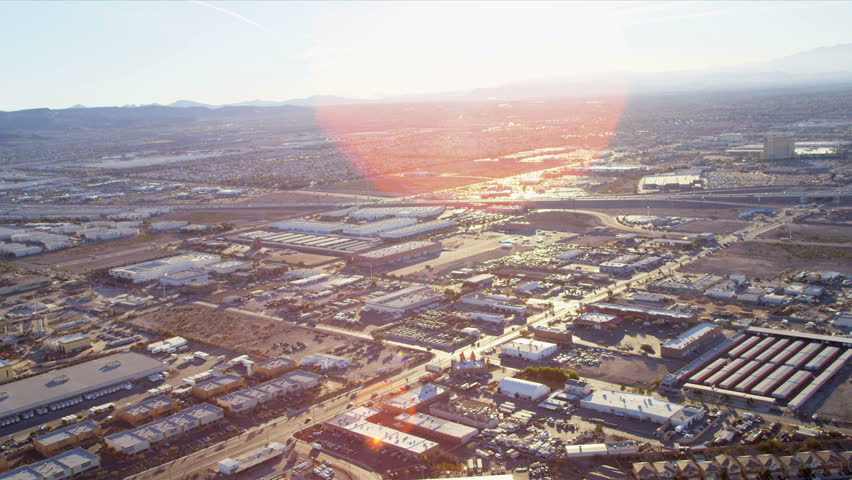Aerial view with sun, lens flare commercial and Industrial suburbs, USA, RED EPIC | Shutterstock HD Video #4242377