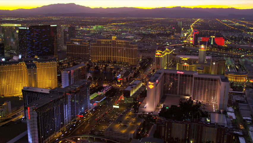 Las Vegas - January 2013: Aerial view sunset Las Vegas illuminated city Hotels and Casinos, Las Vegas, Nevada, USA, RED EPIC | Shutterstock HD Video #4243226